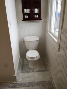 Master bath marlbe framing around toilet